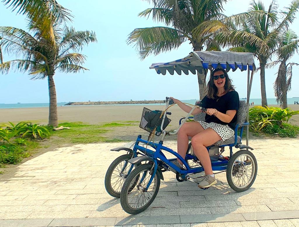Girl sits in a pedicab on Cijin Island, Kaohsiung, Taiwan.