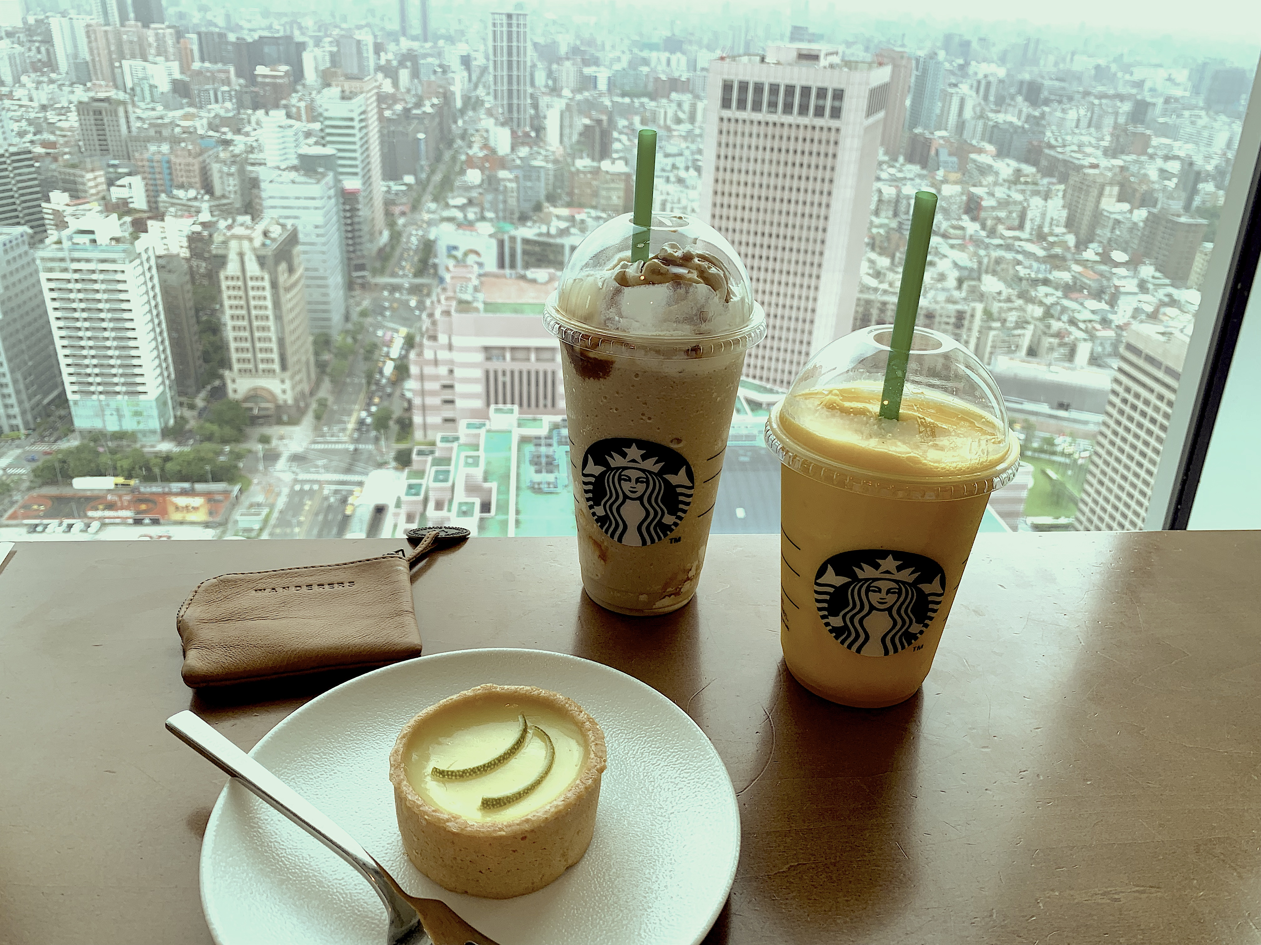 two-drinks-and-view-of-city-from-Starbucks-Taipei-101