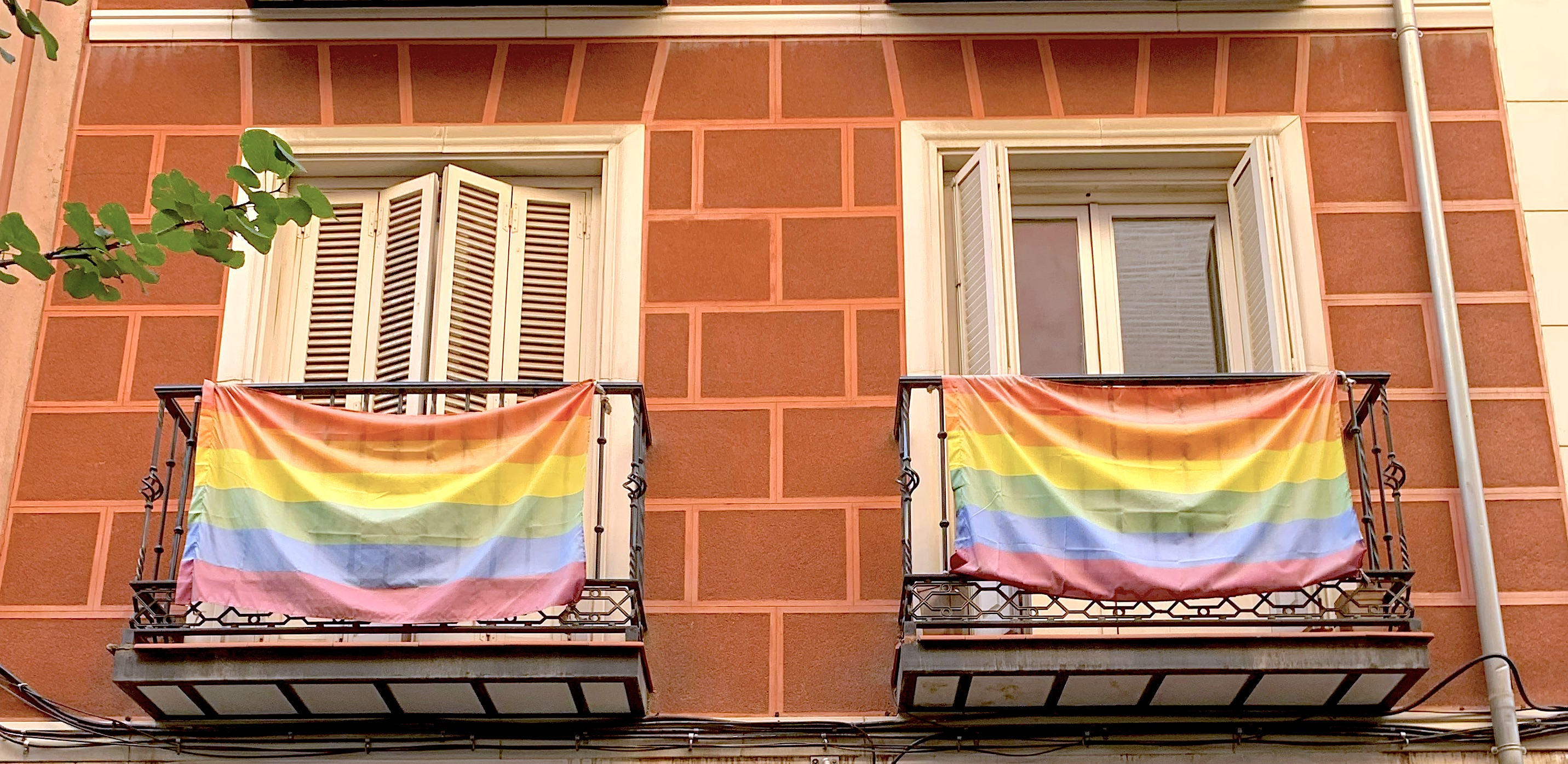 Rainbow flags hang on balconies in Chueca, Madrid
