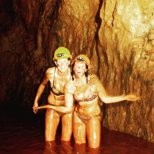Two girls after a mud bath in Phong Nha, Vietnam
